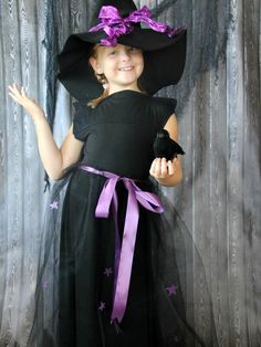 Make a child's witch costume using a black skirt, purple ribbon and some tulle. Pair it with an easy-to-make felt hat for the ultimate Halloween effect.