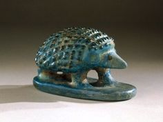 Hedgehog    Middle Kingdom, XII-XIII Dynasty, 1938-1700 B.C.E. Egypt    Now located in the Brooklyn Museum    When food is scarce, hedgehogs retreat into underground dens for long periods, only to re-emerge in times of abundance. The Egyptians associated this behavior with rebirth and thus wore amulets in the form of hedgehogs or left figures such as this one in tombs.