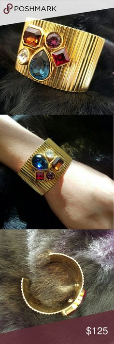 "3x HP Authentic Vintage Givenchy Bracelet This glamorous, gold toned cuff bracelet is authentic vintage Givenchy. 5 large colored crystals. In excellent condition! Measures approximately 2.5 inches in diameter and 1.5 inches wide.   Host Picks  2x  ""Best in Jewelry & Accessories"" ""Weekend Wardrobe""  Givenchy Jewelry Bracelets"