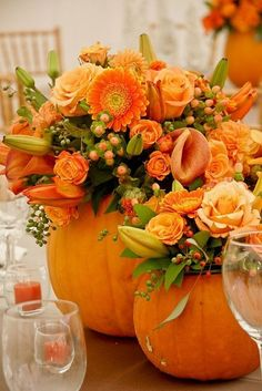 Freshen up your fall wedding with these cute pumpkin flower vases and beautiful orange flowers.