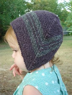 A garter stitch bonnet shaped, like the Baby Surprise Jacket, with mitered decreases.