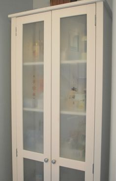 frosted glass cabinet after- using Rust-oleum Frosted Glass spray paint