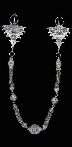 Morocco | Ait Ouaouzguit fibula pectoral; silver, enamel and blue stone | 19th century, Central High Atlas region | 21,850€ ~ sold (Dec '07)