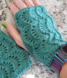 Free Knitting Pattern for Scalloped Fingerless Gloves - These lace wristwarmers are knit flat in 6 row repeat lace and seamed. Rated easy by the designer. Pictured project by stickrista who got 3 pairs of mitts from one skein