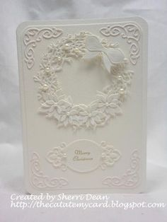 handmade card: Christmas in July by sherrird ... white on white on white ... punchart wreath with flowers, folliage, bow and pearls .. like the corner decorative flourishes emphasizing the rounded corners ... beautiful card!