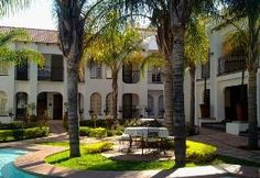 Brits Game lodges and Resorts, Casa Grande is a Spanish style guest lodge situated on the outskirts of Brits. The guest lodge is set among tall palm trees, beautiful roses and lavender. Trees Beautiful, Beautiful Roses, Game Lodge, Spanish Style, Lodges, Resorts, Palm Trees, Lavender, Mansions