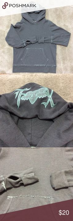 """FOX Distressed Hoodie Soft, gray with teal stitching, raw distressed hems and embroidered FOX logo on the hood. Kangaroo pocket and changeable cuffs...regular, thumb holes or flip for full hand coverage on a cool day. Awesome hoodie. P-P 21 1/2"""" S-H 24"""" Sleeve 27"""" Fox Tops Sweatshirts & Hoodies"""