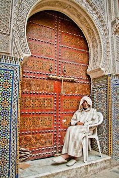 Moroccan tile work (Zellige) and sculpted sheetrock archways.