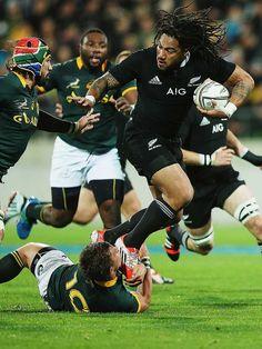 New Zealand's Ma'a Nonu runs through South Africa's Handre Pollard