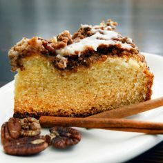 """This coffee cake is simple to make and comes out asa moist, spongy cake with a delicious, cinnamon-heavy streusel topping with just a bit of crunch. The sour cream in the glaze adds a hint of light tartness to perfectly balance an otherwise sweet recipe for those lazy weekend mornings! Yield: 8"""" x 8"""" pan"""