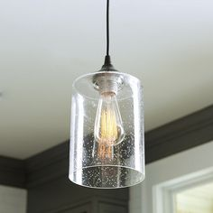 Portfolio 75 in h 6 in w clear textured glass bell pendant light can light adapter seeded glass pendant aloadofball Images