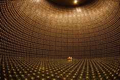 The Super-Kamiokande neutrino observatory - 3,300 feet underground. A neutrino interaction with the electrons or nuclei of water can produce a charged particle that moves faster than the speed of light in water (not to be confused with exceeding the speed of light in a vacuum, which is physically impossible). This creates a cone of light known as Cherenkov radiation, which is the optical equivalent to a sonic boom.