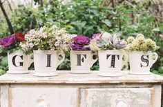 signage in anthropologie letter mugs-