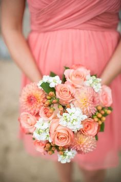 coral wedding bouquet and bridesmaid dress                                                                                                                                                                                 More