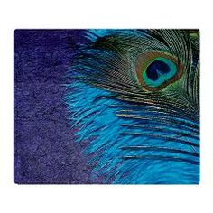 Purple and Teal Peacock Throw Blanket.  The purple background with the teal ostrich feather make the peacock bird feather look student.