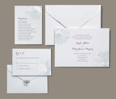 Michaels.com Wedding Department: BRIDES Metallic Flower Invitation The silver floral print on these invitations creates a modern look. This kit includes invitations, invitation envelopes, response cards, response card envelopes, all purpose cards and seals. 30 count.