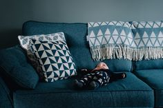 Harris is chilling on the sofa post-feed. These alternative, relaxed family sessions with Harper Scott Photo deliver photos that were fleeting moments and now cherish memories.