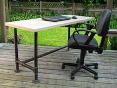 Pipe frame desk with 1-1/2 inch thick Baltic Birch plywood top