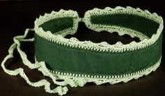 This is a wide dark green headband with a hand crocheted mint green edge and ties designed to keep your hair neat on the days you need it most. Using the ties I crochet onto my headbands allows you to personalize your fit so you are nice and comfy.The headband measures 20 inches long and 2 inches wide in the center. The ties are about 12 inches long.You can machine wash and dry this item in cool temperatures. Use a cool iron if necessary to reshape the edging.HB0021