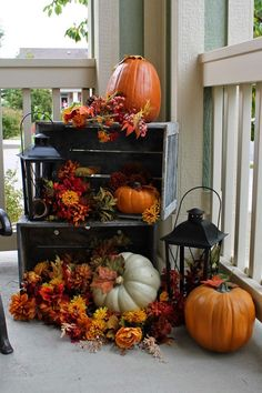 This Fall arrangement is what I like!  Love the lanterns displayed with the crates and pumpkins and Fall flowers!  Fall is here!