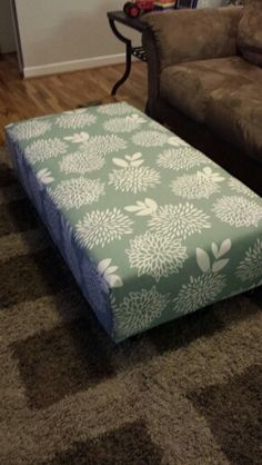 Diy ottoman made from a crib mattress, 2 × 6's and casters.