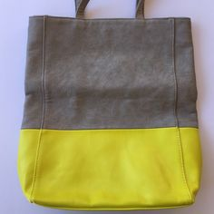 Fun Colorblock Shoulder Tote Perfect pairing for spring and summer outfits!Gray and neon yellow. Made of polyurethane but looks like leather. Never used but has some blemishes from storage (as pictured) but not noticeable when being worn. Francesca's Collections Bags Totes