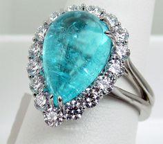 Richard Krementz ring in platinum with 6.42ct pear shaped cabachon paraiba tourmaline with 1.42cts diamond halo