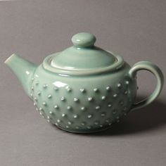Hobnail teapot set with four matching cups in celadon by Tjossem