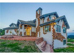 Have you ever seen a home like this one? It's got splashes of mosaic tiles throughout the exterior. It adds a special originality to the home. Golden, CO Coldwell Banker Residential Brokerage $1,500,000