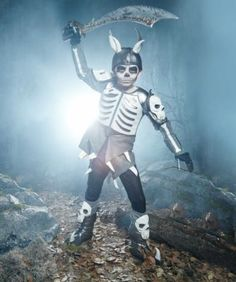 Skeleton Warrior Costume For Boys - exclusively ours - Skeleton warrior's seen a lot of battles - and looks it! Bones, metallic armor and skulls make up your awesome back-from-the-dead look.