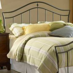 """Arched steel headboard with classic spindle details.   Product: HeadboardConstruction Material: Heavy gauge steelColor: Twinkle blackFeatures:  Classic spindlesGraceful arched topDimensions: Twin: 52'' H x 42'' W x 1.5'' DFull/Queen: 52"""" H x 63"""" W x 1.5"""" DNote: This product is a headboard only. Picture shows the full bed for illustration purposes only."""