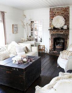 Dark wood floors, white walls, brick fireplace, beach cottage.
