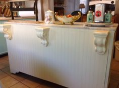 When she slid this old cabinet into her kitchen we were blown away