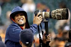 Smile for the camera -  Houston Astros center fielder Carlos Gomez uses a photographer's camera before a game against the Los Angeles Angels on Sept. 21 in Houston. -  © David J. Phillip/AP Photo