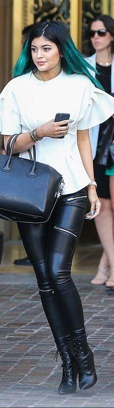 Kylie Jenner: Pants – Zara  Shoes – Christian Louboutin  Purse – Givenchy