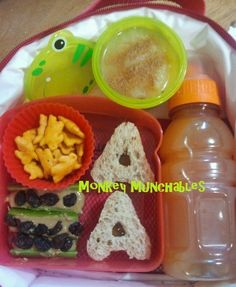 Celebration of A! A shaped Apricot Jelly and Sunflower Butter Sandwiches, Annie's Bunny Crackers, Ants on a log, Applesauce, Apple/Carrot Juice. #Bento #Kids #Lunch #DollarTree #monkeymunchables #monkey #munchables