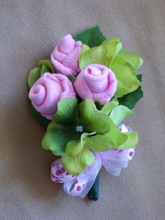 A friend of mine asked if I knew how to make a corsage with baby socks rolled up as flowers for a baby shower. I had never seen one before,...