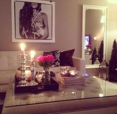 love the glass top on the coffee table and the candle light things and the huge pic very nice