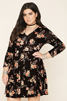 Forever 21+ - A knit floral print dress featuring a surplice neckline, an A-line silhouette, and 3/4 sleeves.