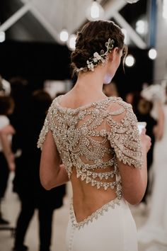 Gemstone backs are just one of the key trends from the newest collection of #AtelierPronovias2018: link in bio! (Pictured: ROCA gown) photo by: @charlotte.van.den.berg