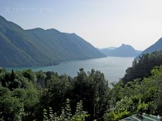 The beautiful view from S. Bartolomeo  The parish of S. Bartolomeo stands just clear of Loggio Valsolda village of Lake Lugano. From the side of the church has a beautiful view toward the Swiss border.
