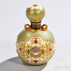Jeweled Coalport Porcelain Perfume Bottle, England, late 19th century, globular body with similarly shaped hinged cover, each with turquoise enamel jeweling to a gold field and adorned with a polychrome jeweled center band and atop the cover