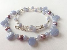 Soft blue lace agate beads with lustrous lavender lilac freshwater pearls and sparkling silver-lined glass beads make this a necklace to treasure. Pretty, romantic and oh so flattering. It is fashioned with a sterling silver carabiner clasp. Blue lace agate is a calming super-soothing