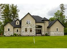 150 Adrien St, Rockland - $724,900 - MLS# 958397 - Stunning custom home in prestigious estate subdivision. Stone and stucco exterior, double door entry into grand foyer. Many features such as rich hardwood & travertine floors thru, gorgeous kitchen, 9′ ceilings soars to 2 story cathedral on main, spacious fully finished lower level w/2 bedrms, full bath & lots of room for play. Attached insulated & heated double garage + 1 detached garage. Minutes from highway, golf & shopping.