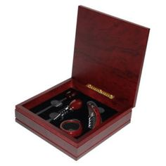 For any wine lover, this wood wine box accessory tool set features the finest in wine tools including a cherry wood finish corkscrew, bottle stopper, drip ring and wine thermometer. Classic as it is classy, this set is for the. Wood Gift Box, Wine Gift Boxes, Gifts For Wine Lovers, Wine Gifts, Wine In The Woods, Electric Wine Opener, Wine Storage, Bottle Stoppers, Dot And Bo