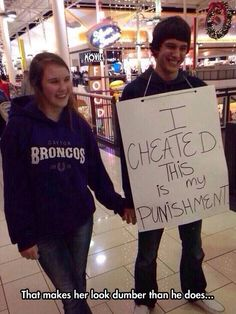 No, it doesn't make her dumber.  It makes her look forgiving, but at a price.  And he was willing to pay that price, publicly, and in a mall.