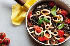 Squid ink pasta adds a gourmet touch to this vibrant calamari pasta.