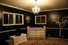 black walls in nursery. creepy but classy lol and love the white furniture and tree. Kind of Tim Burton-esque