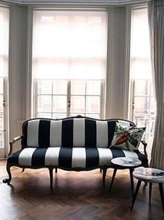 Re-upholster stuffy into chic. Voila! Think of the old chairs you could update!