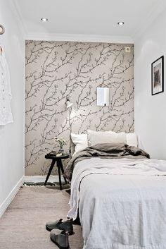 Fundamenta – Otthonok és megoldások – Szingliknek való kicsi, modern, hófehér lakás bontott téglával megspékelve